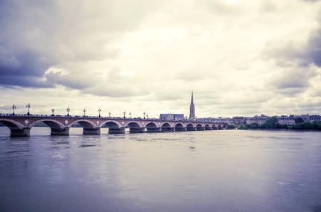 Bordeaux river bridge with St Michel cathedral Stock Photo - 28056052