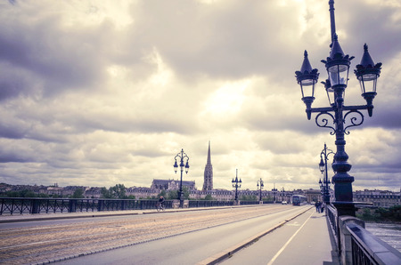 Bordeaux river bridge with St Michel cathedral  photo