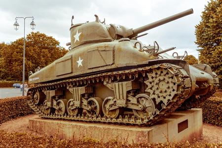 omaha: Omaha Beach, Normandy,Ferance.- August 9: Tanks in American War Cemetery on August 9, 2013. American War Cemetery at Omaha Beach, Normandy (Colleville sur Mer ) France.