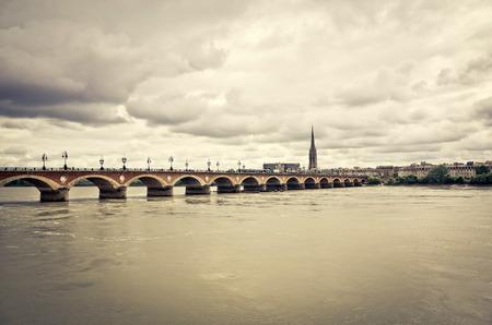 Old stony bridge in Bordeaux, France Europe photo