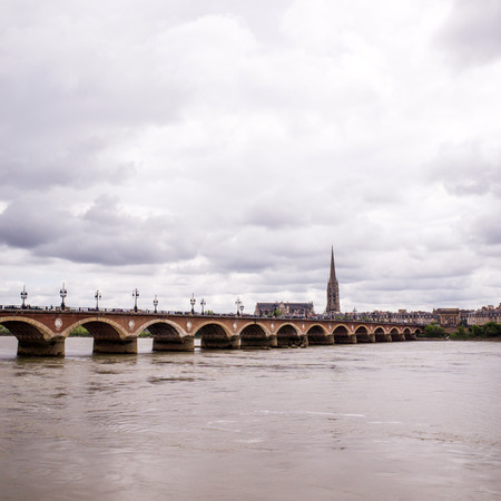 Bordeaux river bridge with St Michel cathedral Stock Photo - 28865473