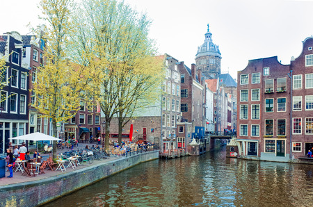 Amsterdam, Netherlands -APRIL 23  Amsterdam canals on April 23, 2014  Beautiful view of Amsterdam canals with bridge and typical dutch houses