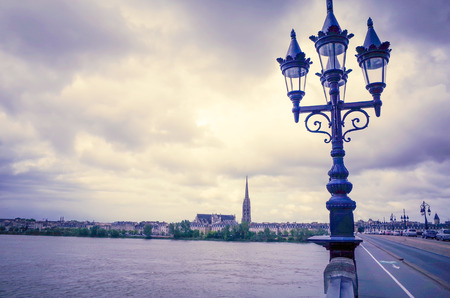Bordeaux river bridge with St Michel cathedral ,France photo