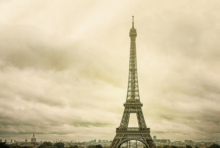 parisian scene: Vintage Eiffel Tower (nickname La dame de fer, the iron lady),The tower has become the most prominent symbol of both Paris and France Stock Photo