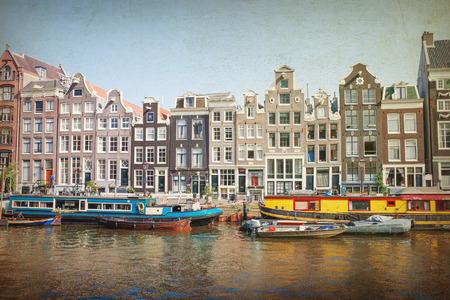 dutch typical: Vintage Amsterdam canals with bridge and typical dutch houses