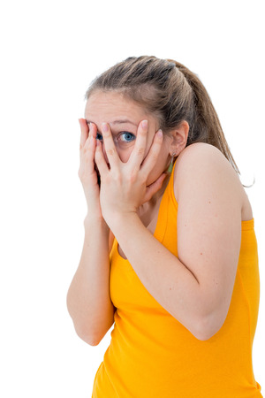 timid: woman hiding face timid on white background Stock Photo