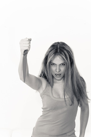 murderess: killer woman with knife on a white background Stock Photo