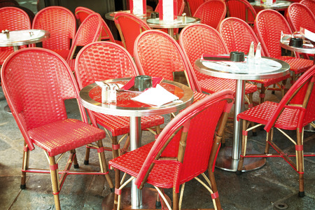 oldfashioned: old-fashioned coffee terrace with tables and chairs,paris France