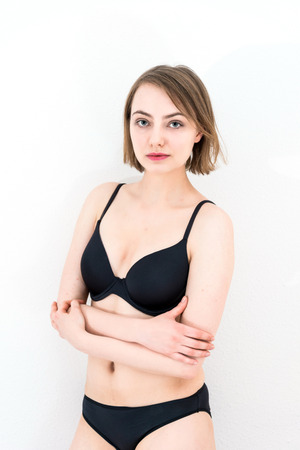 emotional woman: young attractive caucasian woman in lingerie Stock Photo