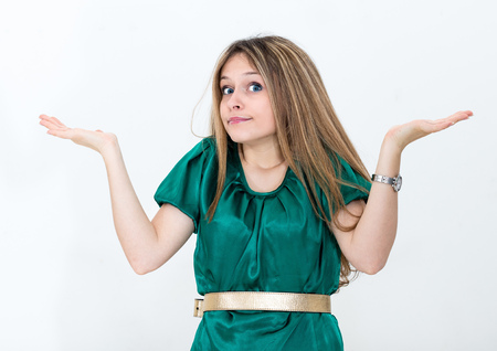 clueless: Clueless young woman against a white background Stock Photo