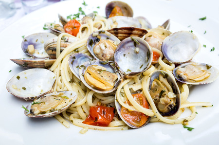 shellfish: Pasta with Clam Dinner Dish on a the table