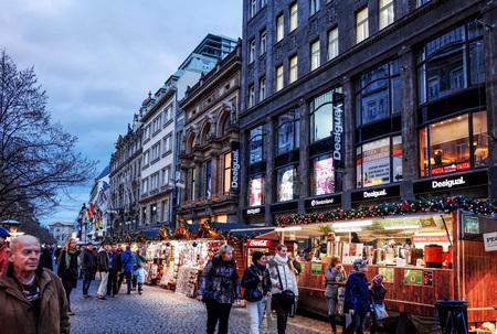 dec: PRAGUE, CZECH REPUBLIC - DEC 23 : Christmas Events. Tourists on foot Street in Prague, Czech Republic. DEC 23, 2014 in PRAGUE