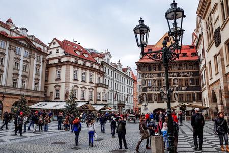 dec: PRAGUE, CZECH REPUBLIC - DEC 23 : traditional christmas.Tourists on foot Street in Prague, Czech Republic. DEC 23, 2014 in PRAGUE