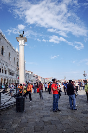 foot bridges: Tourists foot Street in Venice on May 26, 2015. its entirety is listed as a World Heritage Site, along with its lagoon.May 26 VENICE, ITALY
