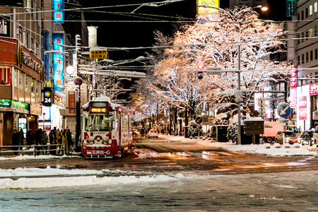 sapporo: SSAPPORO, JAPAN - December 25, 2015: Street view of Buildings around city night, one of the most popular tourist destinations in Sapporo, Hokkaido, Japan.
