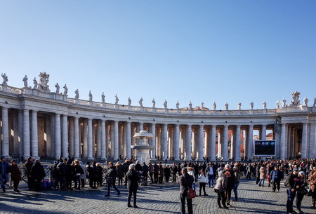 VATICAN CITY,VATICAN-January 6 : Tourists on foot Saint Peters Square in Vatican on January 6, 2015.is the smallest internationally recognized independent state in the world, Jan 6, 2015 in, Vatican.