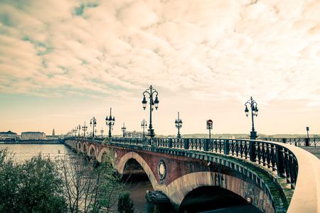st michel: Bordeaux river bridge with St Michel cathedral, France