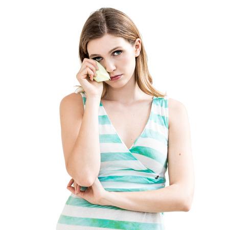 Sad woman with tissues on white background. photo