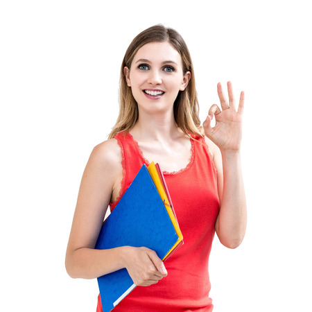 smiling woman with OK gesture and folder on white background. photo