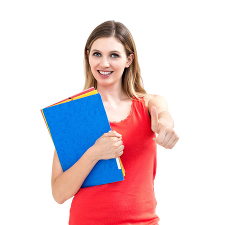 smiling woman with thumbs up gesture and folder on white background. photo