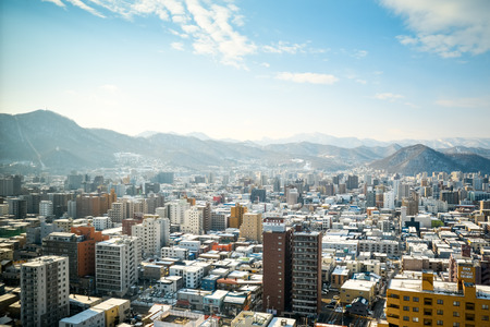 sapporo: SAPPORO, JAPAN - December 22, 2015: Street view of Buildings around city, one of the most popular tourist destinations in Sapporo, Hokkaido, Japan. Stock Photo