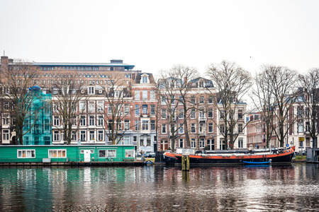 dutch typical: Beautiful view of Amsterdam canals with bridge and typical dutch houses Stock Photo