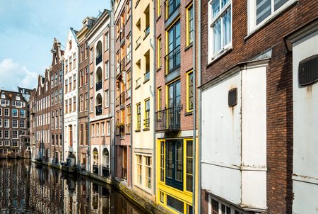 dutch typical: Beautiful view of Amsterdam canals with bridge and typical dutch houses.
