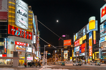 december 25: SAPPORO, JAPAN - December 25, 2015: Street view of Buildings around city night, one of the most popular tourist destinations in Sapporo, Hokkaido, Japan.