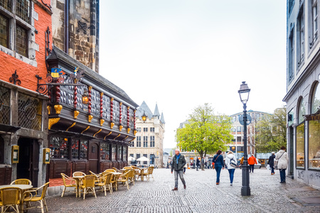 coronation: Aachen, Germany - April 13 : Tourists on foot Street in Aachen, Germany. Aachen was a residence of Charlemagne, and later the coronation place for German kings. April 13, 2016 in Aachen, Germany