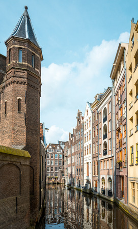 dutch typical: Beautiful view of Amsterdam canals with bridge and typical dutch houses. Europe Stock Photo
