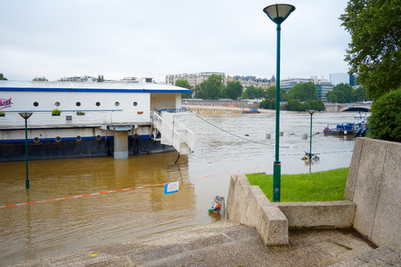 scourge: PARIS, FRANCE - June 4, 2016 : The worst floods in a century have hit Paris, with the Seine continue to rise at a peak of 6,5 meter. Paris, France