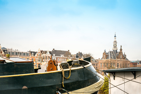dutch typical: Amsterdam, Netherlands.-March 16, 2016 : Beautiful view of Amsterdam canals with bridge and typical dutch houses. Amsterdam, Netherlands