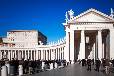 recognized: VATICAN CITY,VATICAN - January 6, 2015 : Tourists on foot Saint Peters Square in Vatican on January 6, 2015.is the smallest internationally recognized independent state in the world, Jan 6, 2015 in, Vatican.