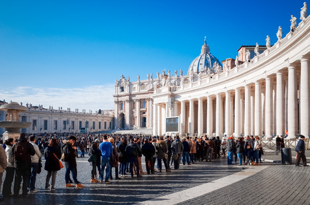 internationally: VATICAN CITY,VATICAN - January 6, 2015 : Tourists on foot Saint Peters Square in Vatican on January 6, 2015.is the smallest internationally recognized independent state in the world, Jan 6, 2015 in, Vatican.