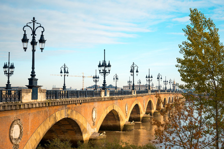 famous industries: Old stony bridge in Bordeaux, France Europe