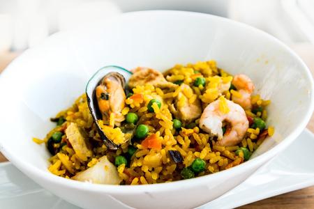 gentrification: Prawn with rice - closeup of prawn with rice - traditionnal spanish food paella