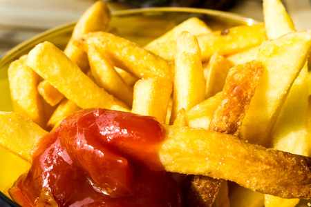 calory: Golden French fries potatoes ready to be eaten Stock Photo