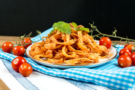 tasty Tagliatelle - Italian meat sauce pasta on the table