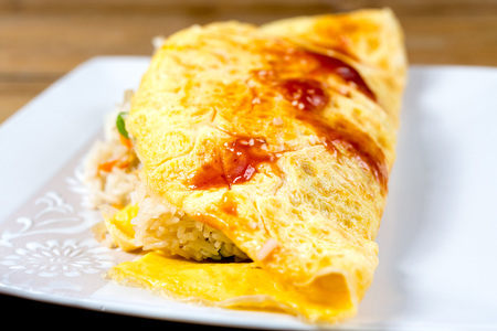Japanese cuisine - omelet rice warpped on a plate