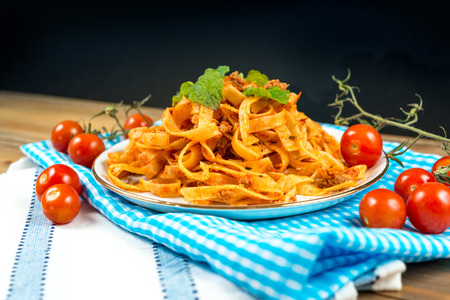 stirred: Spaghetti with aubergine and tomato on a the table