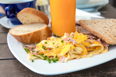 buttery: Breakfast with orange juice and fresh omelet on table