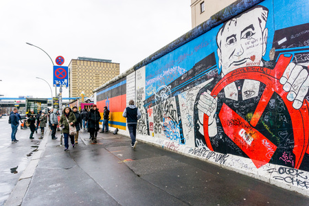 BERLIN, GERMANY- DECEMBER 23, 2016: Berlin Wall was a barrier constructed starting on 13 August 1961. East Side Gallery is an international memorial for freedom. DECEMBER 23, 2016 in Berlin