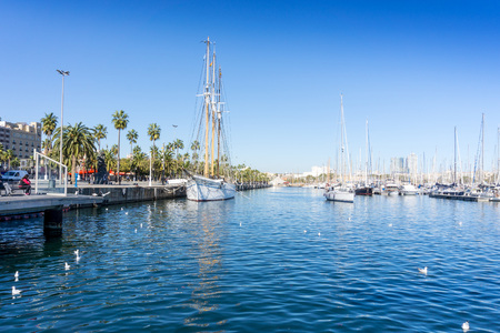 catalunya: BARCELONA SPAIN - February 9, 2017: harbor with boats in Barcelona, is the capital city of the autonomous community of Catalonia in the Kingdom of Spain,February 9, 2017 in Barcelona Spain. Editorial