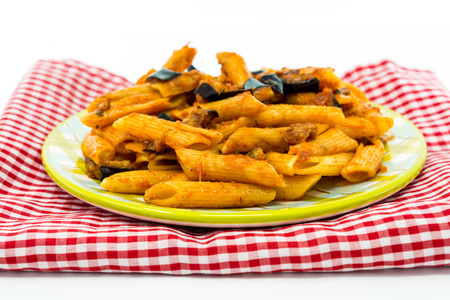 stirred: Pasta with aubergine and tomato on a the table Stock Photo