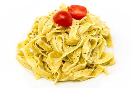 mee: Pasta with pesto sauce and nuts on a the table