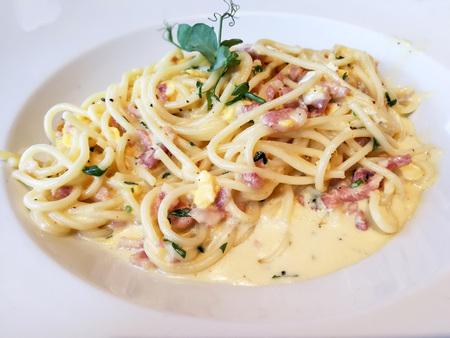 tasty pasta with roast ham on the table