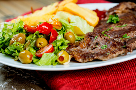 grill: juicy steak beef meat with tomato and french fries