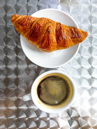 buttered: Breakfast with coffee and croissants on table Stock Photo