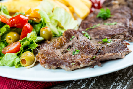 grill: juicy steak beef meat with tomato and french fries  Stock Photo