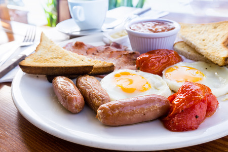 Classical English breakfast with egg and fries Stock Photo